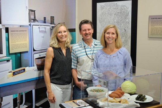 Sandra Webbere (writer), Stephen Evans (editor), and Amme Fleming (designer) in the kitchen gallery of Cedars in the Pines.